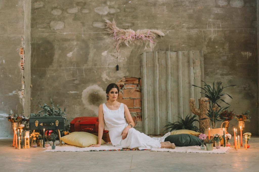 Bride in an abandoned fabric layed down